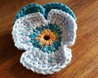 Crocheted pansy brooch