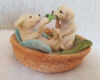 Labradors playing in basket figurine by Heredities