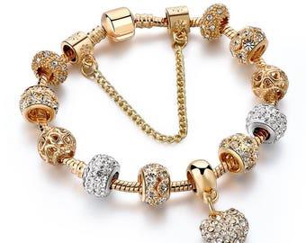 Bracelet in Pandora style with European charms in Gold
