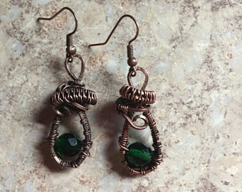 Copper wire wrapped earrings with green crystals
