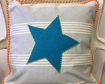 A Handmade Ticking Cushion Decorated with a Teal Felt Star