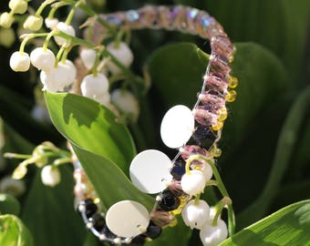 Bracelet beads and sequins woven tangy white black yellow pink