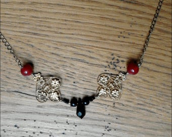 Belle Epoque golden necklace crafted with black and red beads and Swarovski Crystal