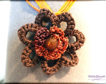 Necklace and crochet pendant in the shape of a flower with a big pearl - in the brown and orange tones