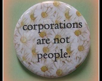 "2 1/4"" pinback button. Sorry but they are not."