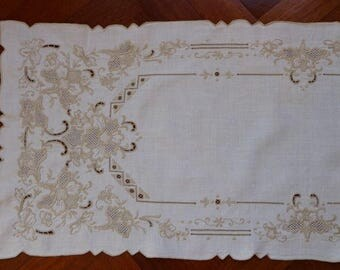 Linen table runner with intricate embroidery.  All proceeds to charity VACD Ltd