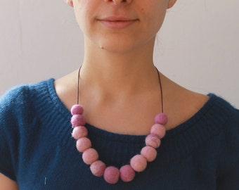 Sweet pink woolen necklace.