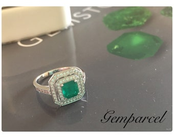 Natural Emerald 0.86 ct. setting on 18K WG Ring and diamonds