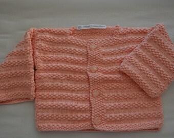 Salmon baby vest.