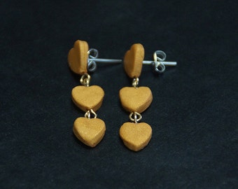 Polymer clay small triple heart earrings with stainless steel posts.