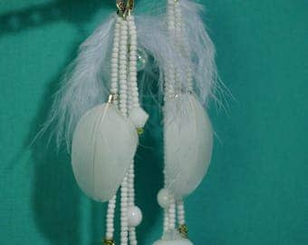White hanging earring with feathers, beads and glass elements