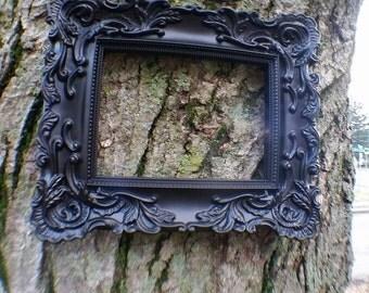 Black rectangular ornate frame