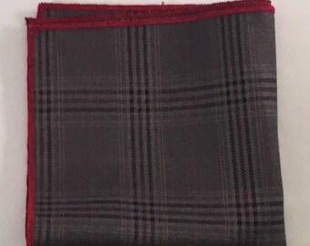 Grey, black, and red plad pocket square