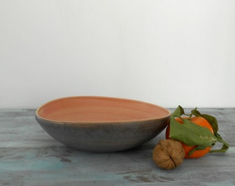 Curved bowl in ceramic in different colours