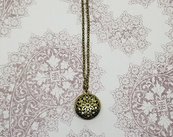 Bronze Flower Necklace with a Sparkle Center