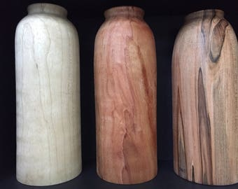 Natural wood vases made from select woods.