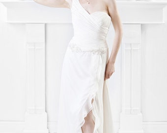 One shoulder bodice with beaded appliques and skirt with front slit. SIZE 8