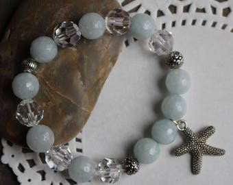 Antique pewter starfish bracelet, pale blue glass beads, clear Swarovski crystals, casbah beads, elastic bead cord, B138