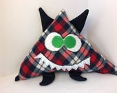 Bubba the plushie monster -- upcycled flannel skirt and jeans