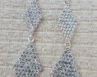 Beautiful long dangly crystal earrings for pierced ears only