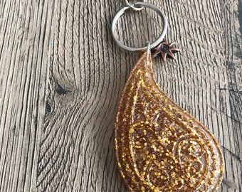 Golden key ring with charmes