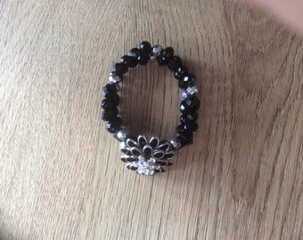 Double beaded bracelet with flower centre piece,in black and silver