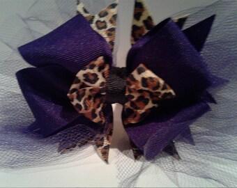 Cheeta and purple bow
