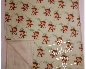 Swinging monkeys baby blanket