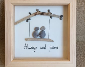 Pebble art - couple on a swing