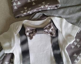 New baby boy clothing set. Includes swaddling blanket, knit cap, and onsie.