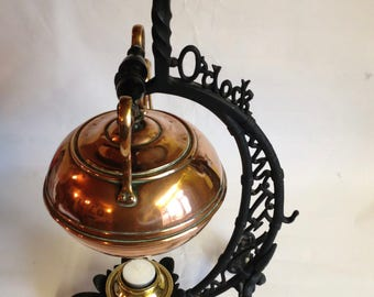 Antique Bradley & Hubbard Copper teapot on stand which says 5 o'clock