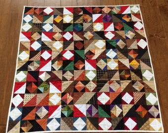 Adult lap quilt / scrap quilt / hand quilted / multi colored squares and triangles / reversible