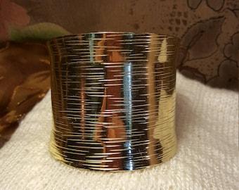 Beautiful gold tone wide cuff bracelet