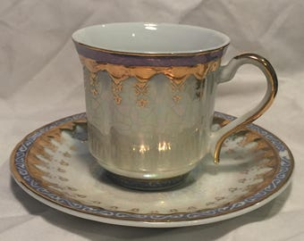 Pearlescent, Blue, and Gold Teacup with Saucer