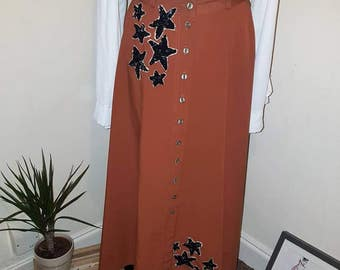Upcycled 70s midi skirt with sequin stars and buttons down.