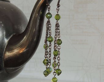 Long earrings with green glass beads