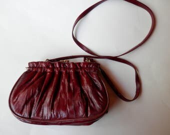 Vintage fortuneEEL Cranberry red purse with gold colored clasp and strap