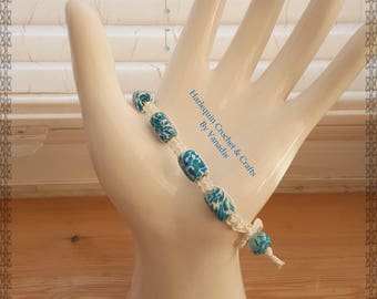 Beautiful blue and white beaded macrame bracelet. Made from polymer clay and cotton, measuring 1 x 24cm