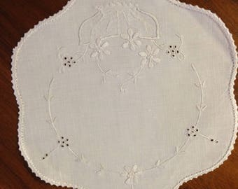Vintage hand embroidered white on white round scalloped doily, 21 cm