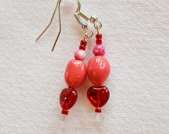 Beautiful handmade beaded earrings with pink, handpainted seeds