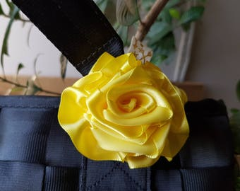 Yellow satin ribbon rosette for Harveys seatbelt bag