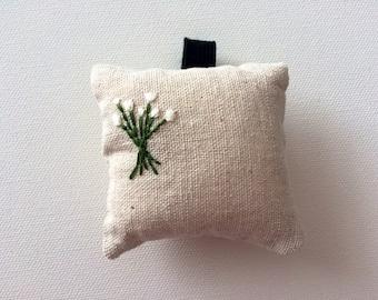 Wrist pincushion hand embroidered