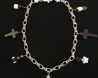 Sterling silver charm bracelet with black and white natural stone cross and star charms.