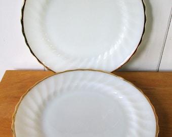 2 vintage Fire King milk glass swirl plates