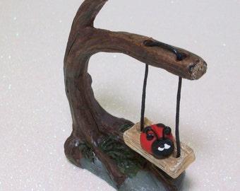 Ladybug on a tree swing: miniatures fairy garden, gnome or terrariums