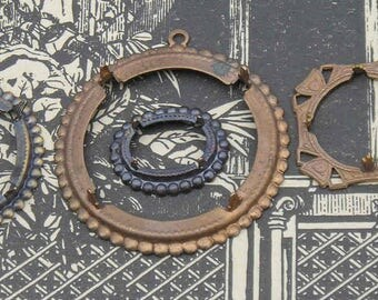 Four fabulous vintage dark brass pronged settings to have in your stash..