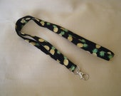 Pineapples on black - handmade fabric lanyard .. HALF inch wide