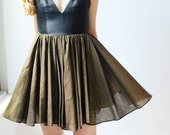 Short flirty cocktail dress in black and deep gold