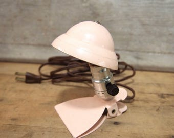 Free Shipping  Fun little light pink hooded bed or reading clip light Helmet Night light As Found not working
