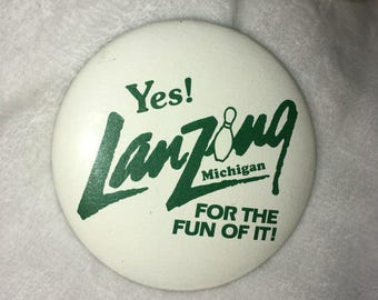 "1 Vintage mid 80s White Pin ""Yes Lanzing Michigan For the Fun of It "" with Green Font and a Bowling Pin"
